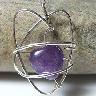 amethyst jewellery heart shaped amethyst wrapped silver pendant
