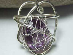amethyst jewellery faceted amethyst in heart cage
