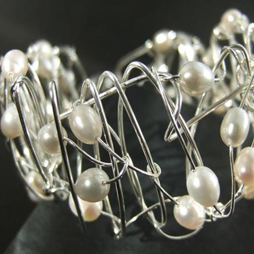 Pearl jewellery uk online store with a selection of pearl and silver bangles , neclaces and earrings