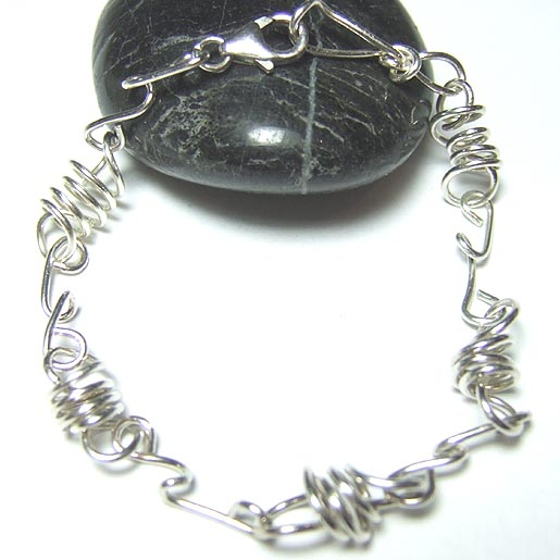 silver bracelets spring links and twisted links