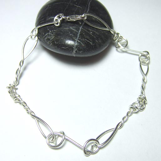 silver bracelets twisted and circular links